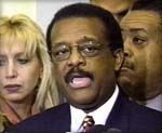 Linda-with-the-late-Johnnie-Cochran-at-a-Press-Conferene-Announcing-the-Settlemet-of-the-NJ-Turnpike-4